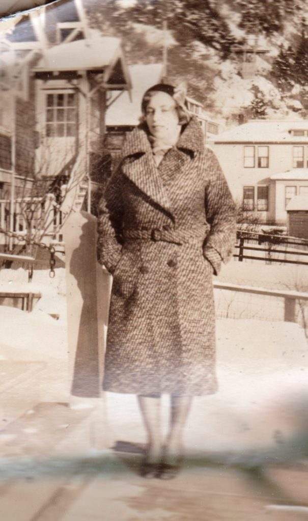 woman in double-breasted coat, Alaska, 1930s