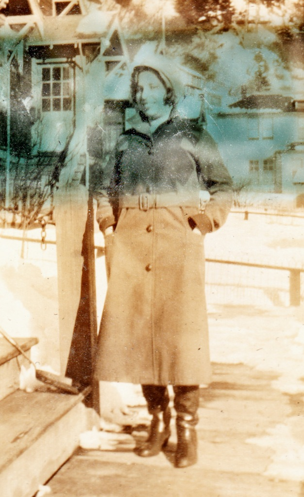 woman in long coat and boots, Alaska, 1930s