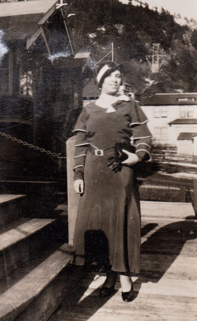 woman in dress with caped sleeves, Alaska, 1930s